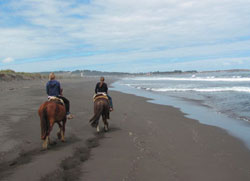 Horseback riding down the beach in Pichilemul